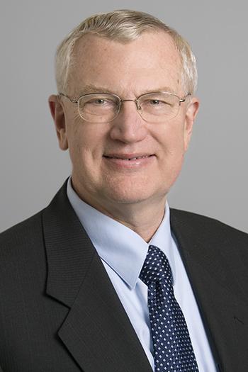John E Tomaszewski
